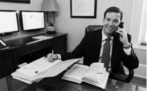attorney at desk on phone