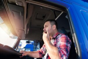 drowsy truck driver yawning